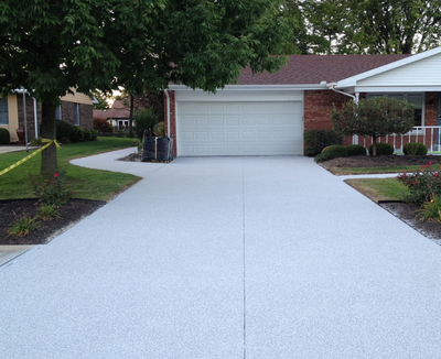Concrete driveway textured and cut.