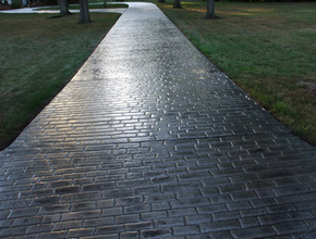 Dark brick stamped driveway done by Franklin Stamped Concrete.