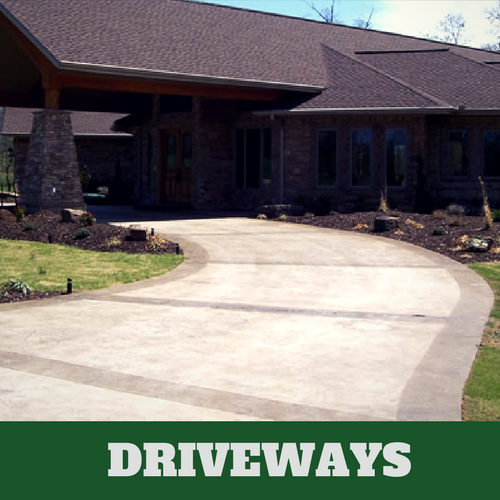 Two toned colored concrete driveway in Franklin, TN with brick home.