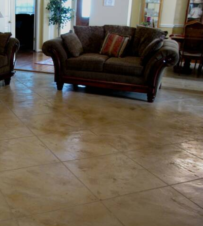 Interior concrete floors that are polished and cut to resemble ceramic tile.