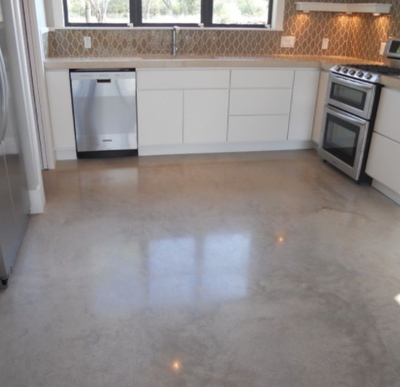 Fun designed kitchen floor made out of polished concrete.