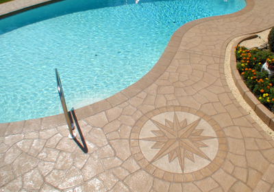 Stamped concrete pool deck, that is polished and clean.