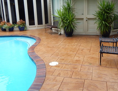 Residential pool with stamped concrete pool deck in Roanoke.
